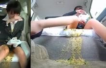 Asian slut vomits in car